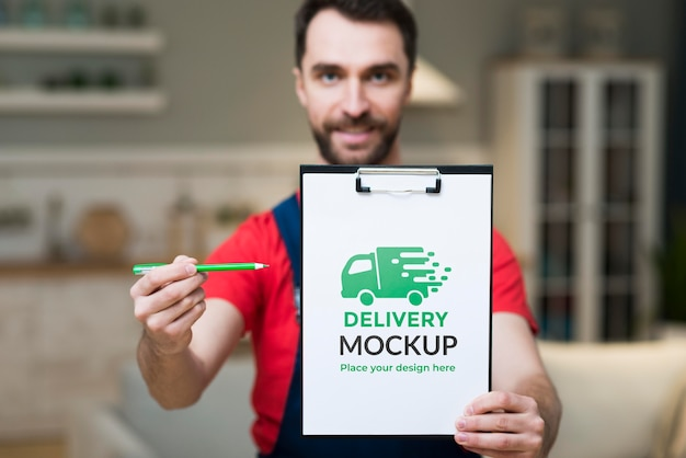 Front view of delivery man in house