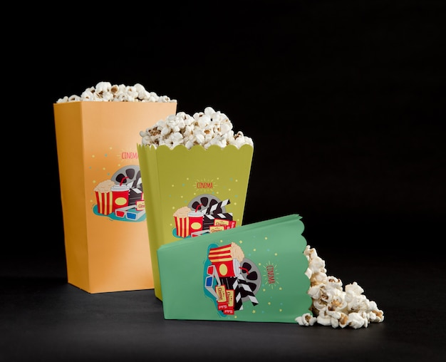 Front view of filled cinema popcorn cups