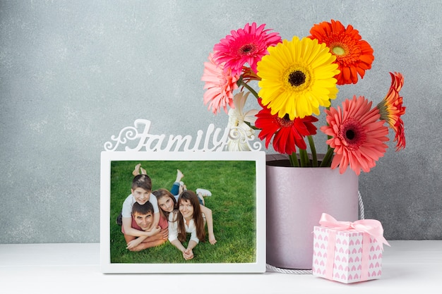 Front view of flowers on with frame on table