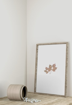 Front view of frame decor with vase on surface