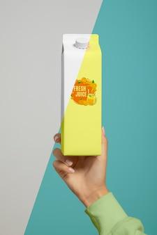 Front view of hand held juice carton