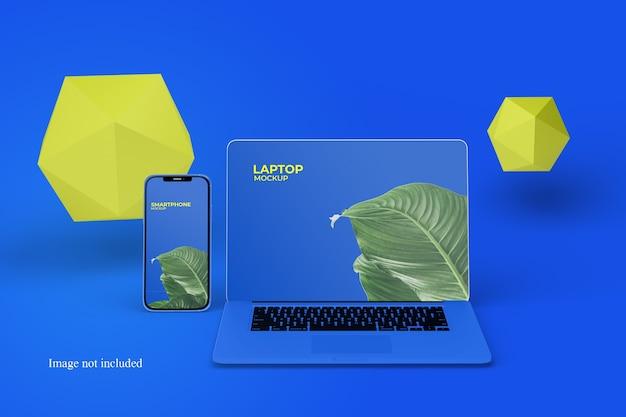正面図のラップトップとスマートフォンのモックアップ
