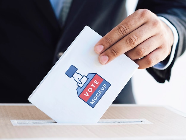 Front view male putting ballot mock-up in box