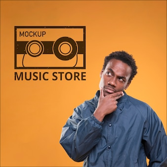 Front view of man thinking about something for music store mock-up