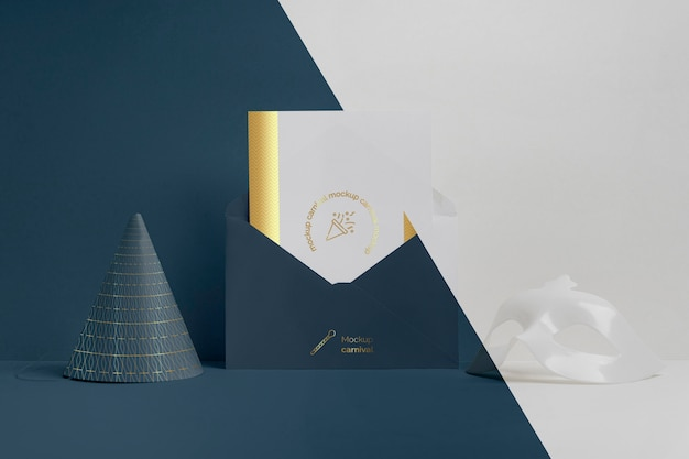 Front view of minimalistic carnival invitation in envelope with cone and mask