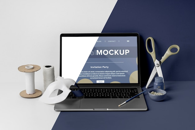Front view of minimalistic carnival mock-up with scissors and laptop Premium Psd
