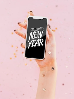 Front view new year minimalist lettering on phone