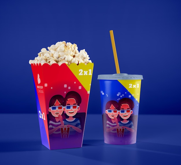 Front view of one cup with straw and cinema popcorn