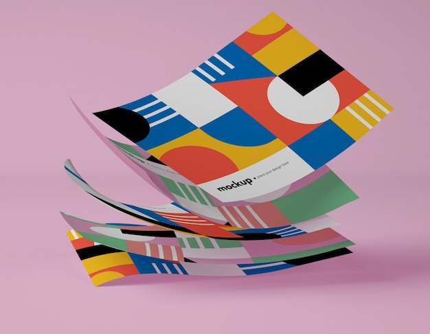 Front view of papers with multicolored geometric shapes