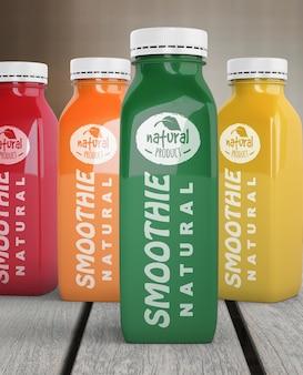 Вид спереди пластиковых бутылок с различными фруктовыми или овощными соками