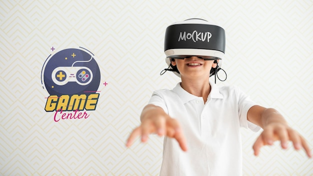 Front view smiley kid wearing vr glasses