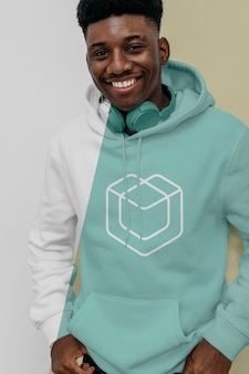 Front view of smiley man in hoodie with headphones