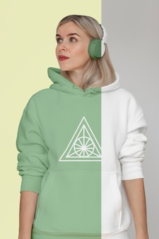 Front view of stylish woman in hoodie with headphones Free Psd