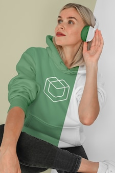 Front view of stylish woman in hoodie with headphones