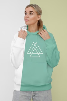 Front view of stylish woman in hoodie