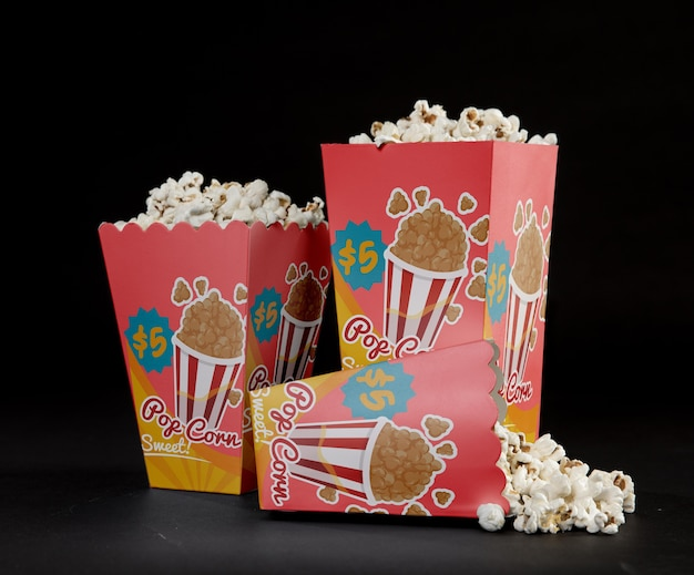 Front view of three cinema popcorn cups