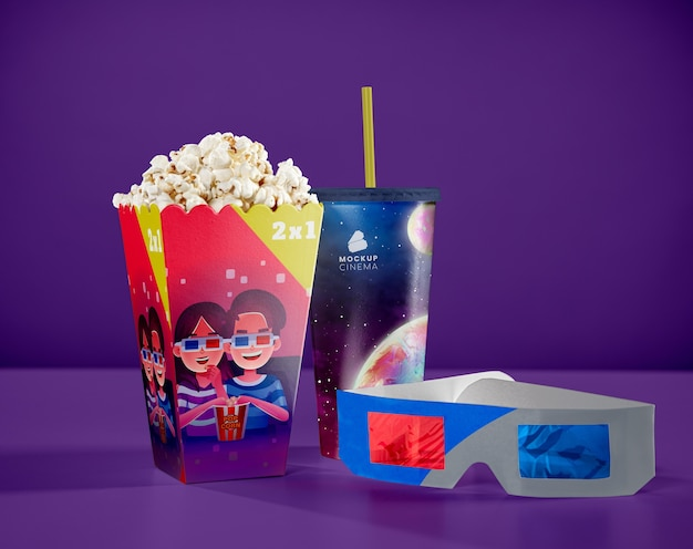 Front view of threedimensional glasses with cinema popcorn and cup with straw
