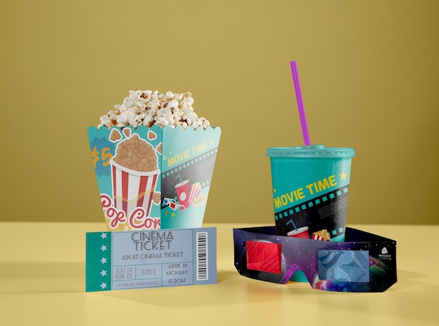 Front view of threedimensional glasses with cinema popcorn and cup