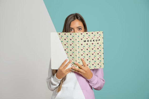 Front view of woman holding book