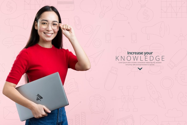 Front view woman holding a mock-up ad for it courses