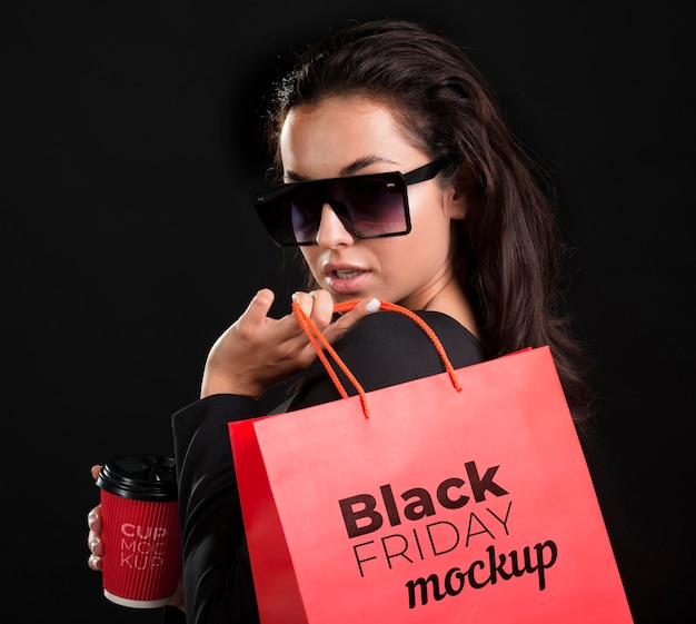 Front view of woman with black friday concept