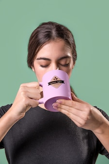Front view woman with pink mug