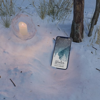 Frozen scene with phone and candle