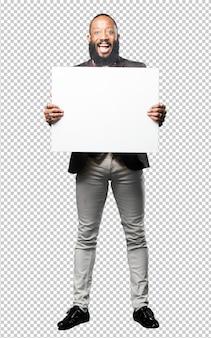 Full body black man holding a blank placard
