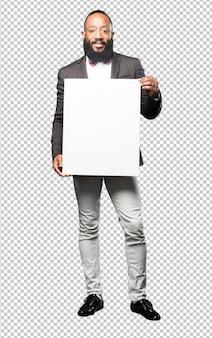 Full body black man holding a placard