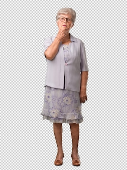 Full body senior woman doubting and confused, thinking of an idea or worried about something