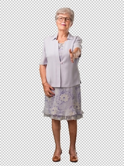 Full body senior woman reaching out to greet someone or gesturing to help, happy and excited