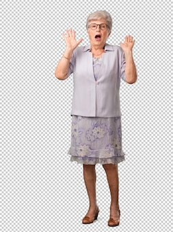 Full body senior woman screaming happy, surprised by an offer or a promotion