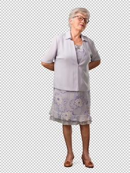 Full body senior woman with back pain due to work stress, tired and astute