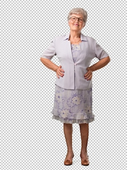 Full body senior woman with hands on hips, standing, relaxed and smiling, very positive and cheerful