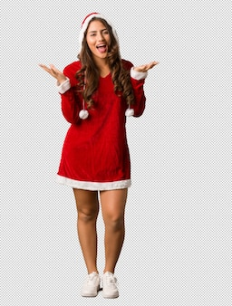 Full body young santa curvy woman celebrating a victory or success