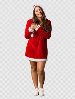 Full body young santa curvy woman doing a romantic gesture