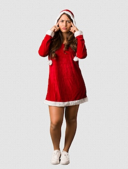 Full body young santa curvy woman doing a concentration gesture