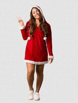 Full body young santa curvy woman doing a gesture of victory