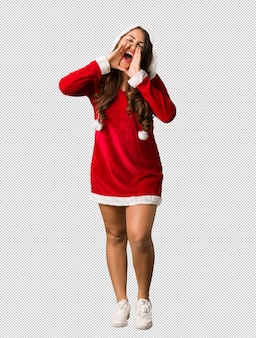 Full body young santa curvy woman shouting something happy to the front