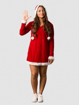 Full body young santa curvy woman showing number five