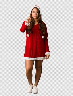 Full body young santa curvy woman showing number one
