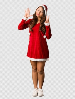 Full body young santa curvy woman showing number seven
