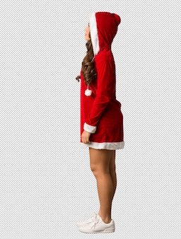 Full body young santa curvy woman on the side looking to front