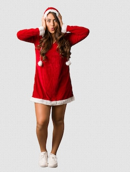 Full body young santa curvy woman surprised and shocked