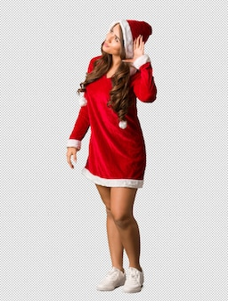 Full body young santa curvy woman try to listening a gossip