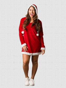 Full body young santa curvy woman winking, funny, friendly and carefree gesture