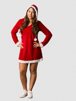 Full body young santa curvy woman with hands on hips