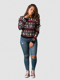 Full body young woman wearing a christmas jersey coughing, sick due a virus or infection