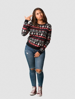 Full body young woman wearing a christmas jersey doing a suicide gesture