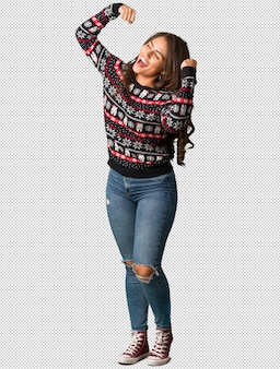 Full body young woman wearing a christmas jersey who does not surrender